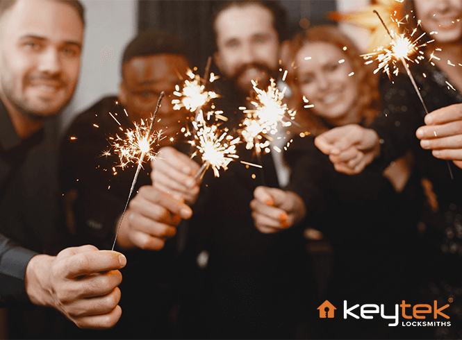 Group of friends celebrating with sparklers