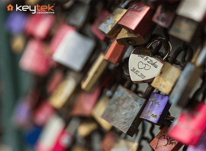 Multiple love locks attached to a bridge