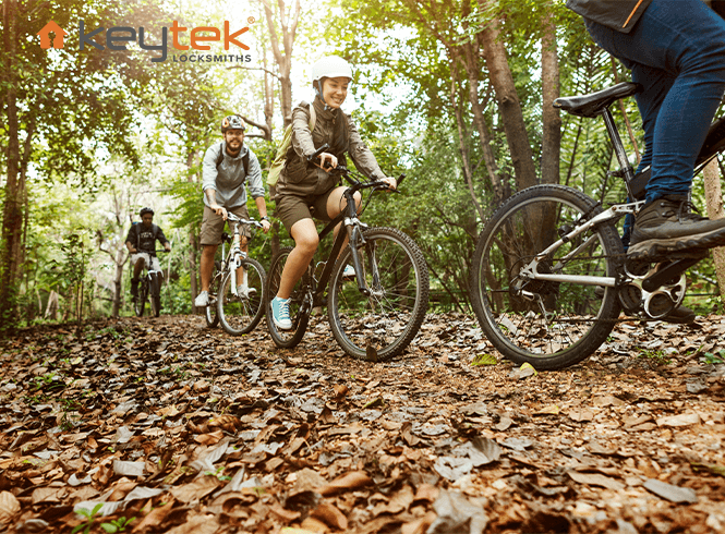 group of friends riding bikes through the forest