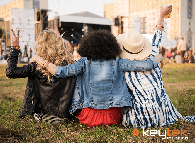 Friends sat together at a festival