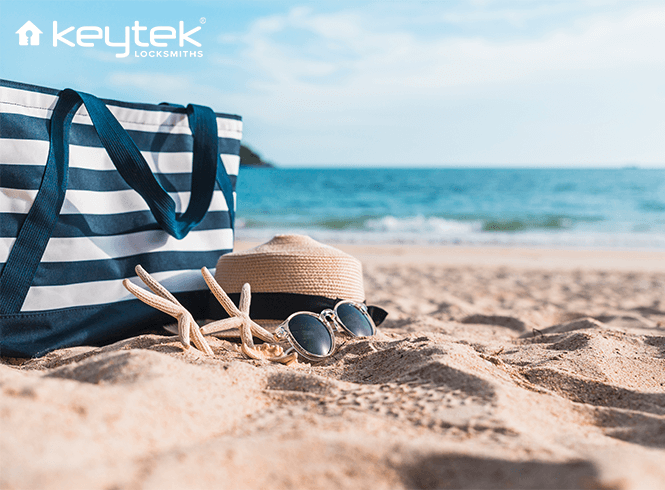 summer hat and beach bag on the beach