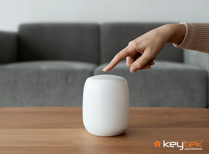 Someone about to touch white smart speaker