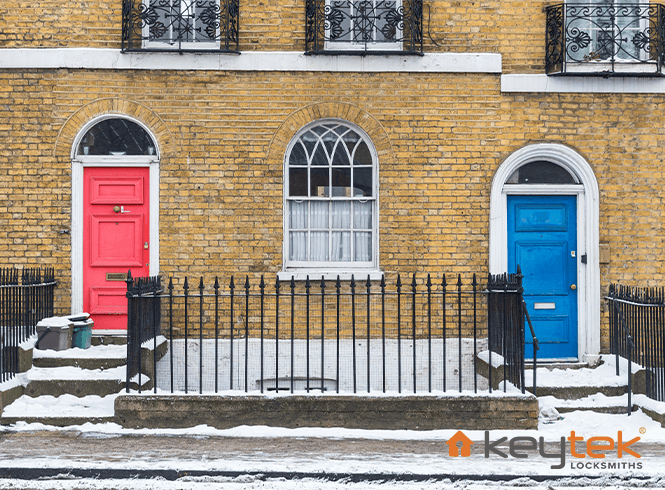 Terranced houses, one with a red door and one with blue door