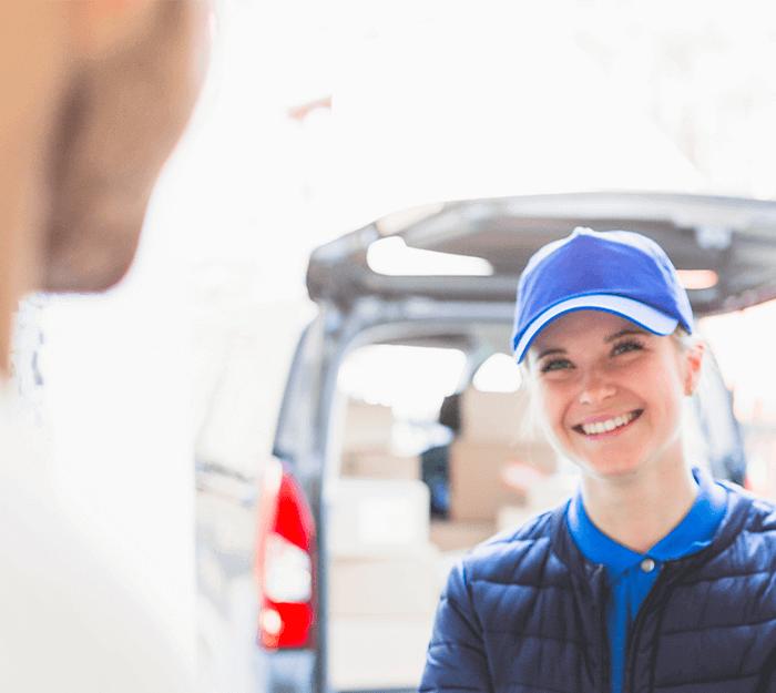 female locksmith smiling at customer