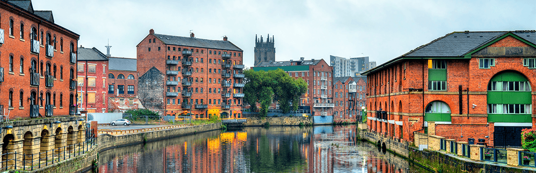 view of buildings from the aire river in leeds