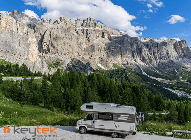 parked Motorhome with mountains in the background