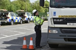 traffic police, police cars, traffic cones