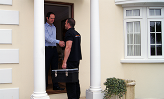 keytek locksmith attending customer at their home
