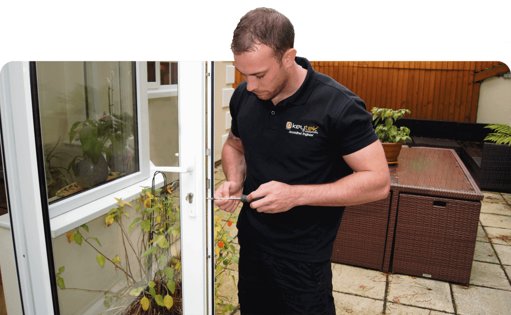 keytek locksmith with tools working on upvc patio door