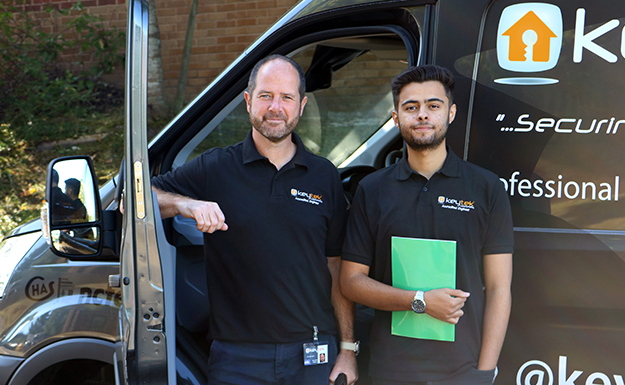 Find a locksmith, two locksmiths stand outside Keytek van