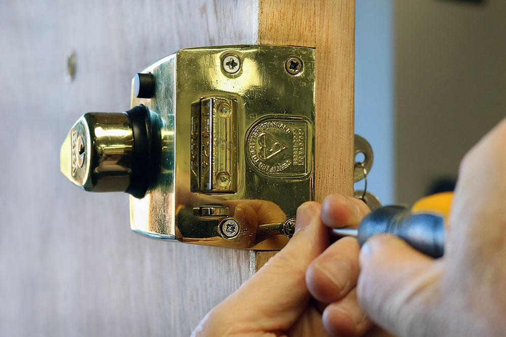 yale lock being worked on with screwdriver