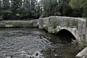stone bridge in Ashford over the river