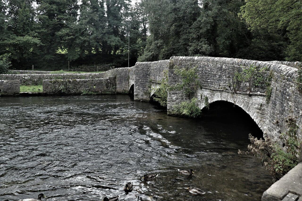 stone bridge in Ashford over the river