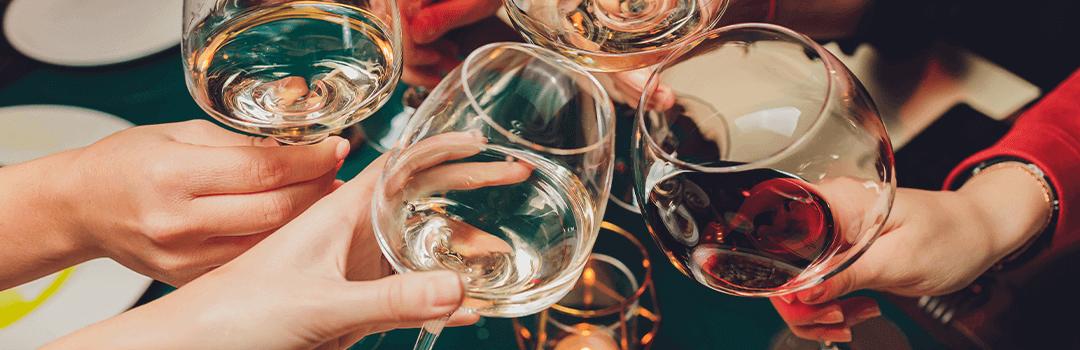 friends bring wine glasses together