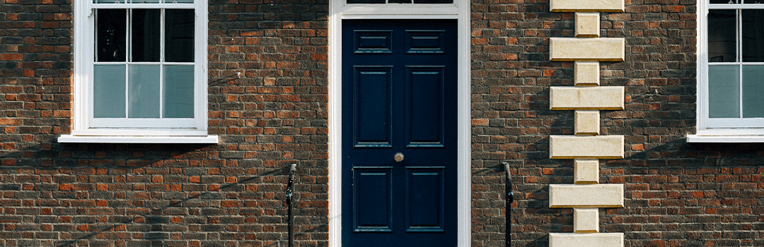 Blue door to a red brick house
