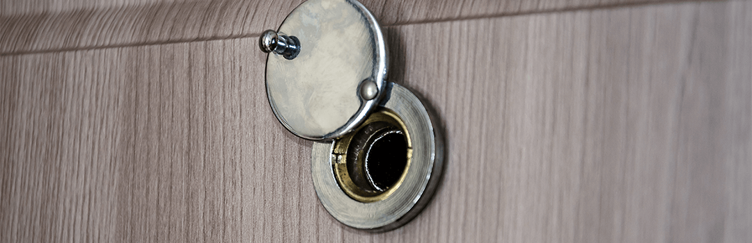 silver metal peephole on wooden door