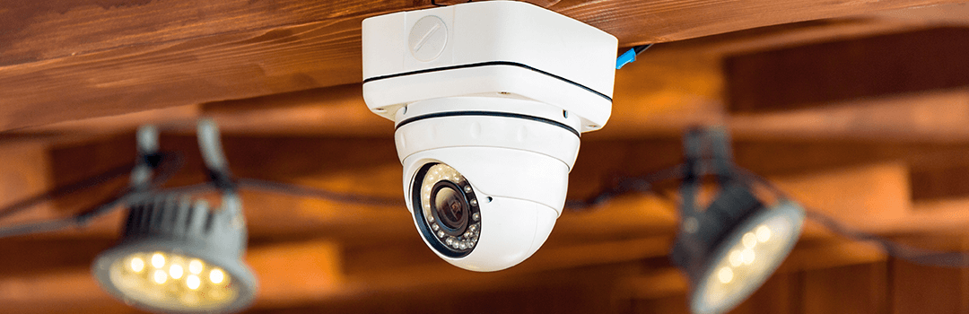 white home outdoor security camera